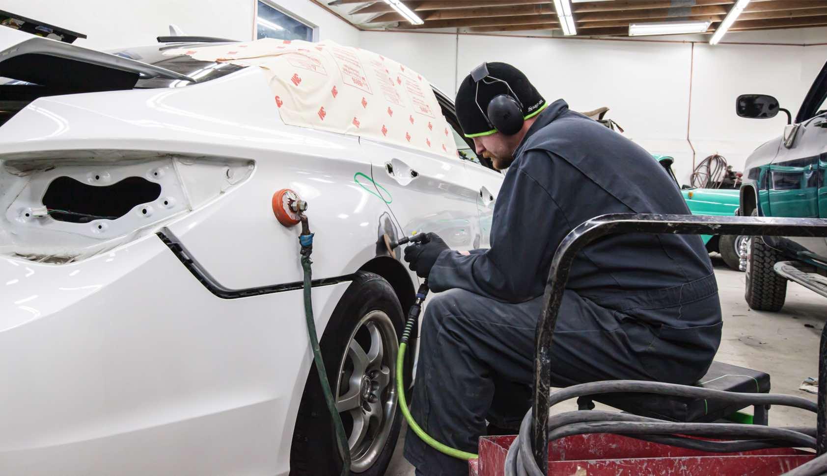 Carstar | Tomas Moriarty preps a car for painting