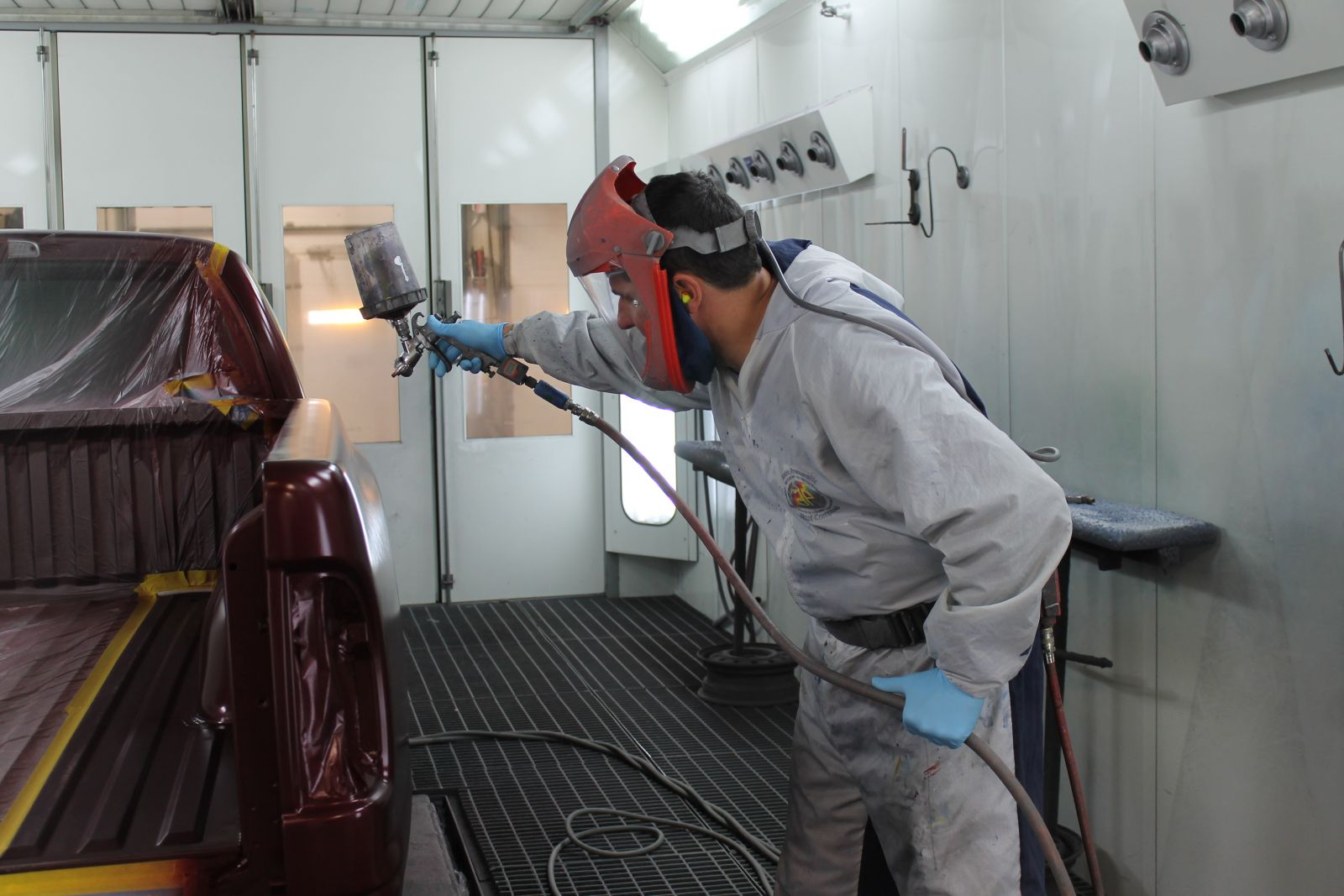 Carstar | Ray's CARSTAR: Painter in process