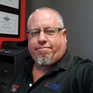 Brian Dean, the shop manager at Crystal CARSTAR Collision.