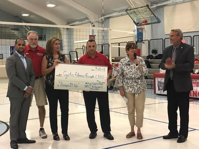 Action CARSTAR - VASJ Lady Viking Volleyball donate to local Cystic Fibrosis Foundation